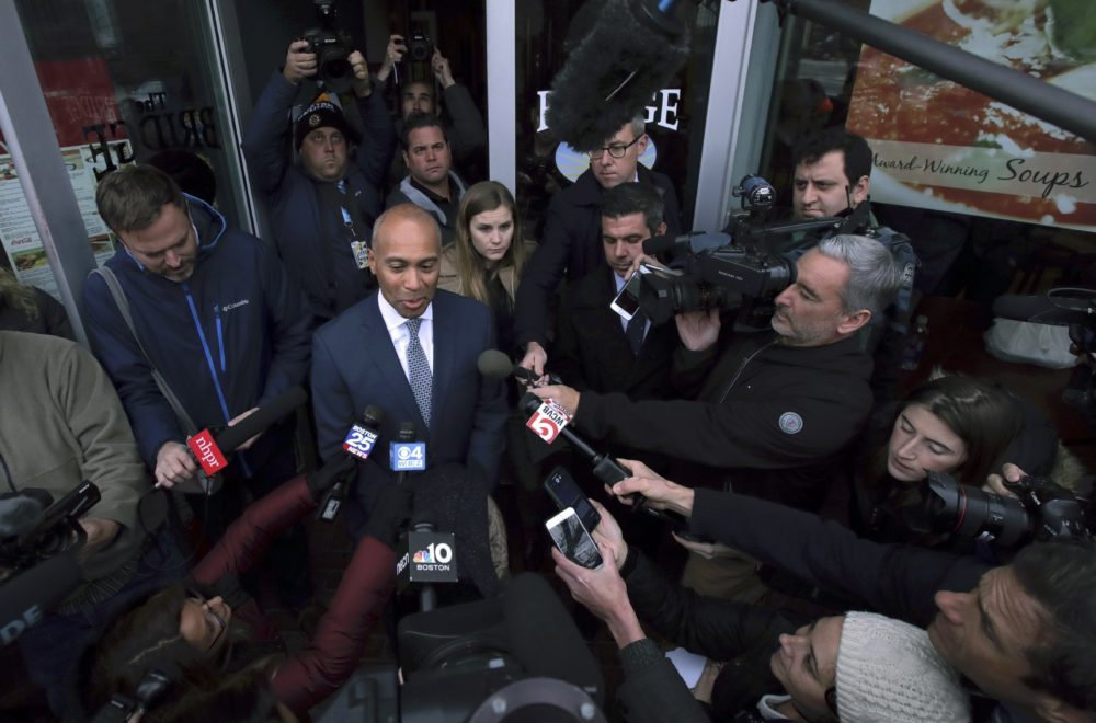 Hours after entering the presidential race, former Massachusetts Gov. Deval Patrick spoke with reporters outside The Bridge Cafe in Manchester, N.H., Thursday. (Charles Krupa/AP)