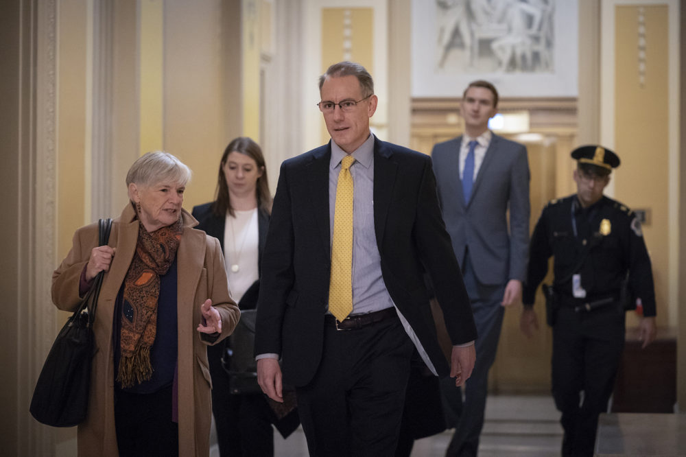 Mark Sandy a career employee in the White House Office of Management and Budget arrives at the Capitol to testify in the House Democrats' impeachment inquiry about President Donald Trump's effort to tie military aid for Ukraine to investigatio
