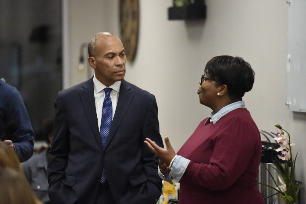 Democratic presidential candidate and former Massachusetts Gov. Deval Patrick speaks with a business owner during a campaign stop,Tuesday in Columbia, S.C. (Meg Kinnard/AP)