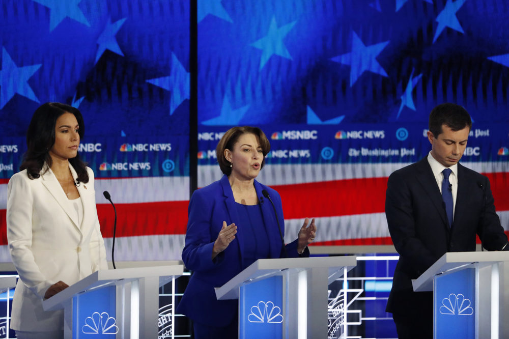 Democratic presidential candidate Sen. Amy Klobuchar, D-Minn., center, speaks as South Bend, Ind., Mayor Pete Buttigieg and Rep. Tulsi Gabbard, D-Hawaii, listen during a Democratic presidential primary debate, Wednesday, Nov. 20, 2019, in Atlanta. (John Bazemore/AP)