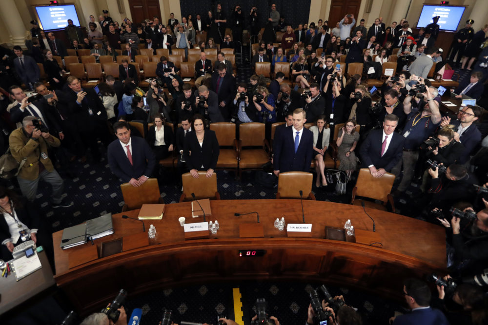 Former White House national security aide Fiona Hill, second from left, and David Holmes, a U.S. diplomat in Ukraine, stand behind their chairs as they arrive to testify before the House Intelligence Committee Thursday during a public impeachment hearing. (Andrew Harnik/AP)