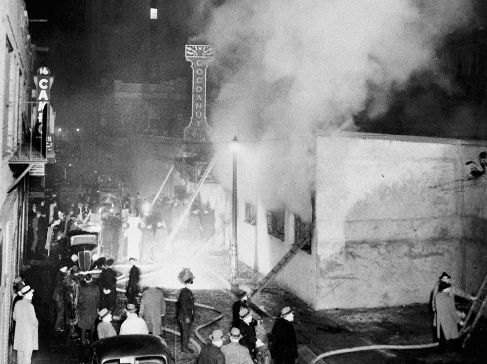 In this Nov. 28, 1942 file photo, smoke pours from the Cocoanut Grove nightclub, right, during a fire in the Back Bay section of Boston, where 492 people died and hundreds more were injured. The fire still stands today as the nation's deadliest nightclub fire and led to stricter enforcement of fire codes and to innovations in the treatment of burn victims. (AP Photo File)