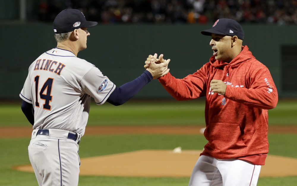 Houston Astros manager AJ Hinch, left, and Boston Red Sox manager Alex Cora shake Hanes before Game 1 of the 2018 American League Championship Series. Both are subjects in MLB's sign stealing investigation.  (David J. Phillip/AP)