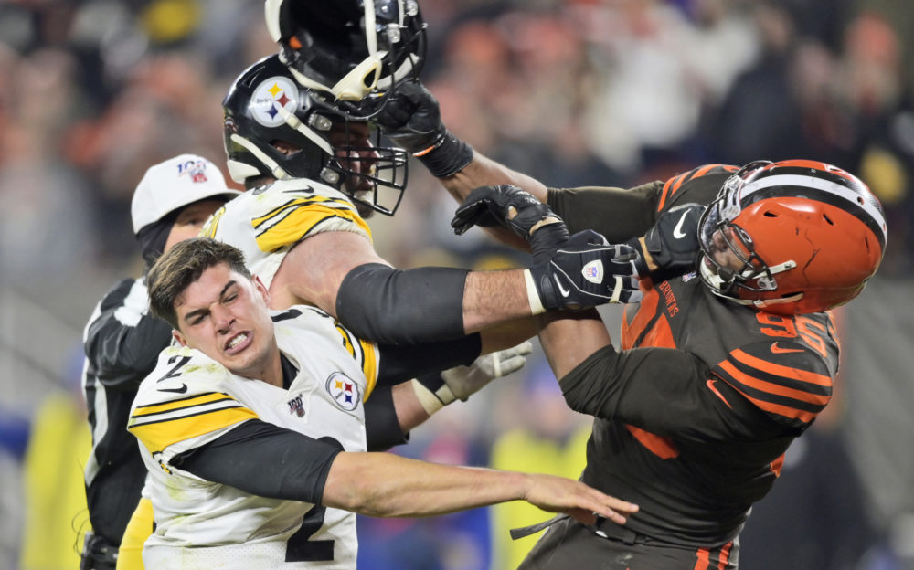 Myles Garrett hits quarterback Mason Rudolph with a helmet during an NFL football game Nov. 14, 2019.  (David Richard/AP)