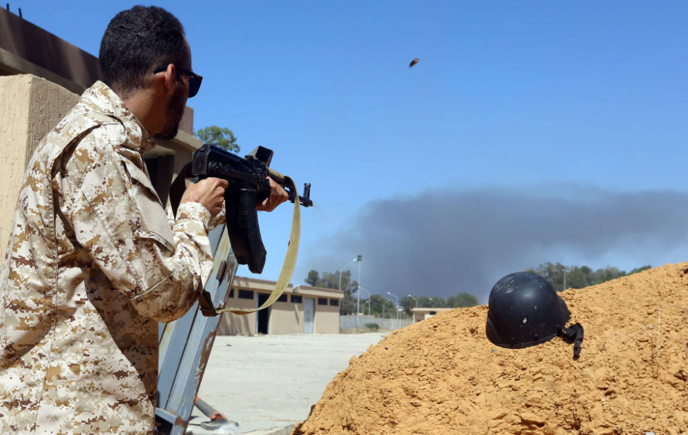 """Troops loyal to military strongman Khalifa Haftar said they shot down a warplane of rival forces of Libya's unity government near Tripoli and captured its foreign """"mercenary"""" pilot. (Mahmud Turkia/AFP/Getty Images)"""
