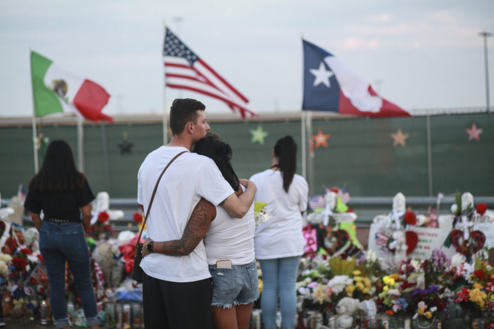People gather at a makeshift memorial honoring victims of a mass shooting outside Walmart on Aug. 15, 2019 in El Paso, Texas. (Sandy Huffaker/Getty Images)