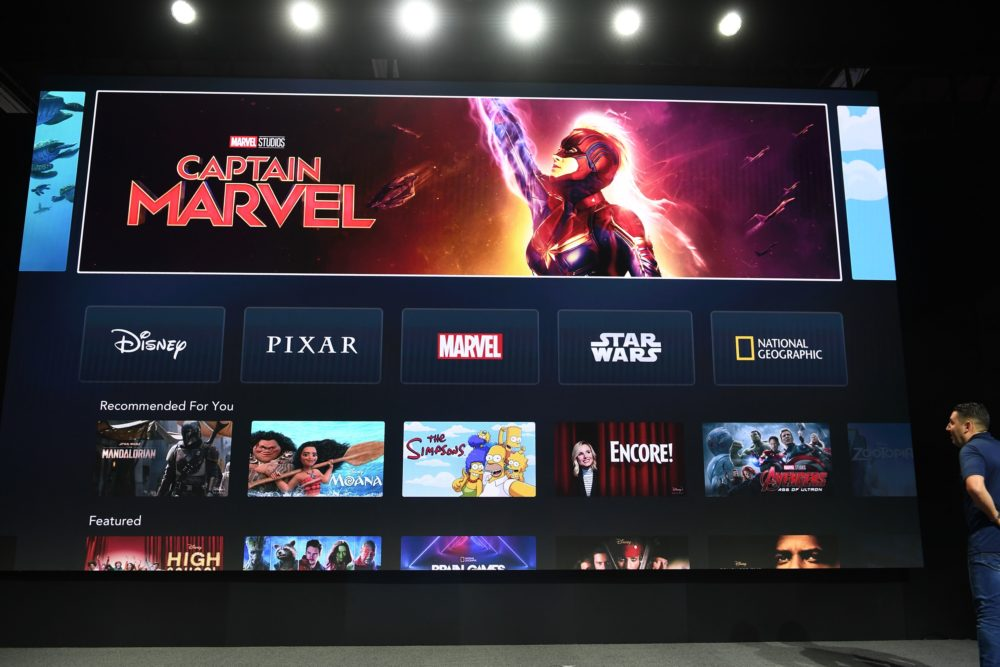 "The interface of Disney+ streaming service is displayed on Apple Inc.'s AppleTV at the D23 Expo, billed as the ""largest Disney fan event in the world,"" on Aug. 23, 2019 at the Anaheim Convention Center in Anaheim, Calif. (Robyn Beck/AFP via Getty Images)"