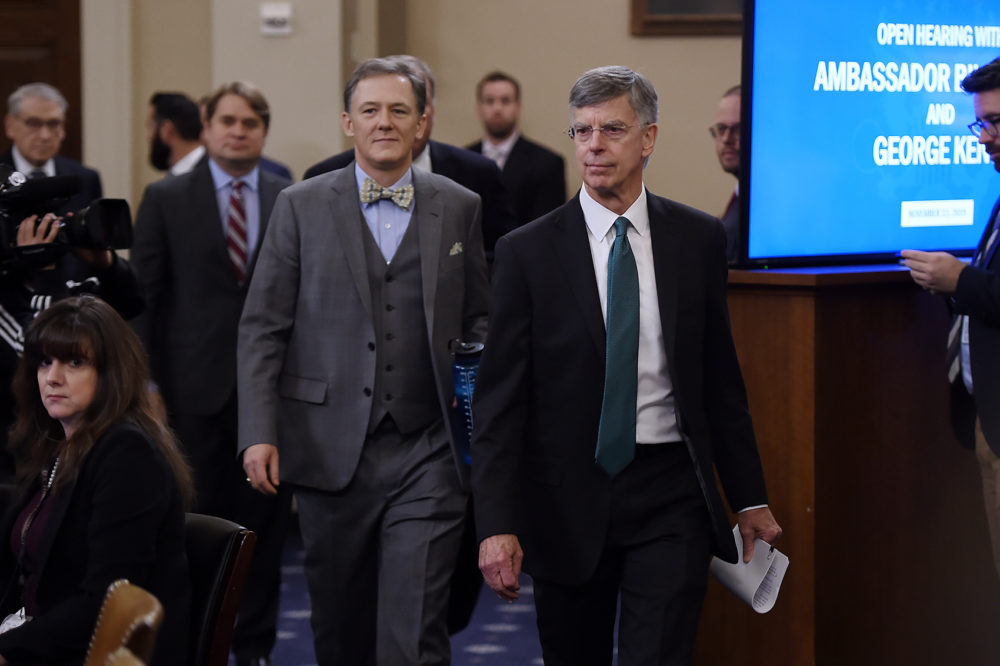 George Kent, the deputy assistant secretary of state for European and Eurasian Affairs, and Ukrainian Ambassador Bill Taylor (front), the top diplomat in the U.S. embassy in Ukraine, arrive in the impeachment inquiry into President Trump Washington on Nov. 13, 2019. (Olivier Douliery/AFP via Getty Images)