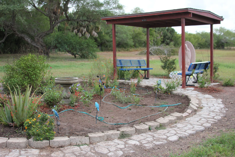 The 'Butterfly Garden' at La Posada Providencia Respite Center is a small, quiet outdoor space where people can relax or pray. (Yasmin Amer/WBUR)