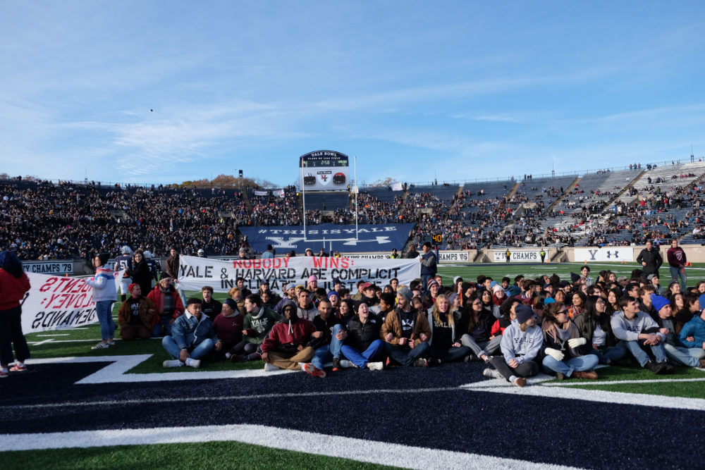 Hundreds of students and alumni take to the field in protest of climate change during Harvard-Yale rivalry football game on Saturday, Nov. 23, 2019 (Courtesy of Fossil Fuel Divest Harvard).