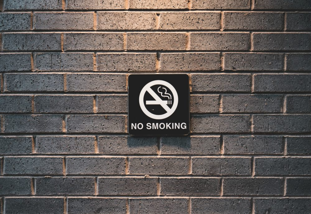Reframing the national conversation from smokers' rights, which pitched smokers against non-smokers, to public health, which united the American people against Big Tobacco, helped drive down smoking rates. (JJ Shev/Unsplash)