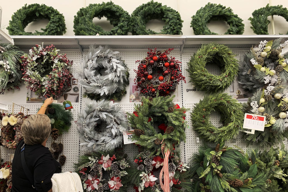 A woman looks through holiday wreathes on sale at a retail store during on Saturday, Nov. 9, 2019, in Pembroke Pines, Fla. (Brynn Anderson/AP)