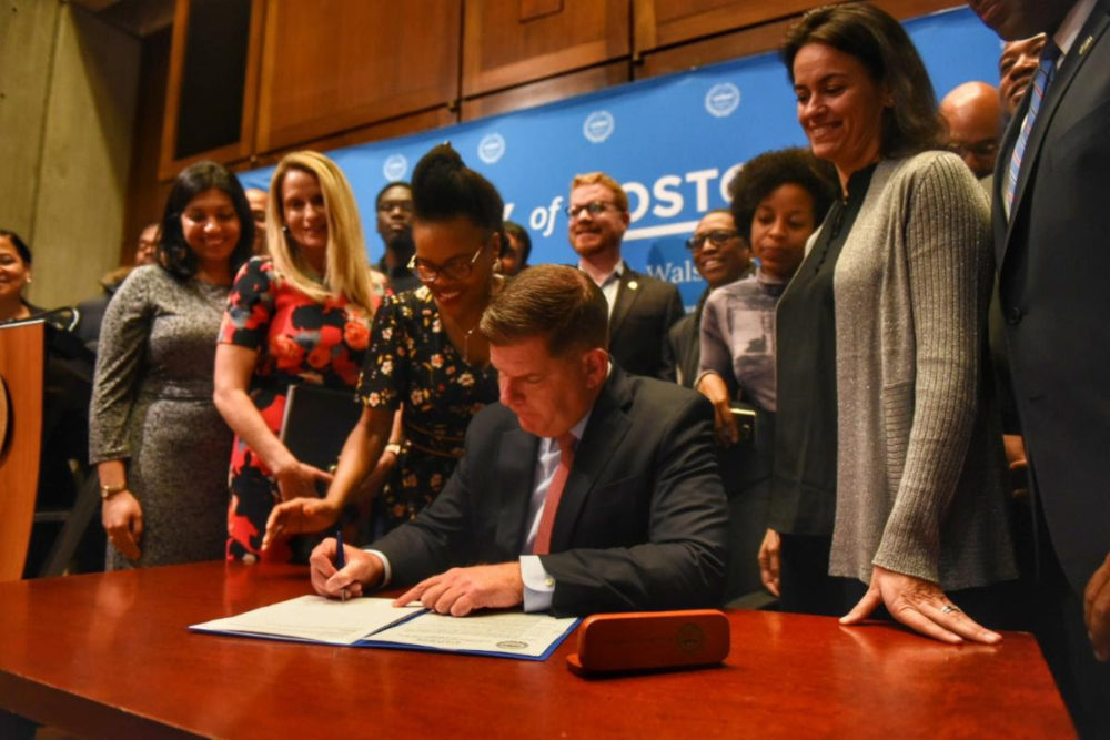 Mayor Marty Walsh signs the ordinance Tuesday. (Courtesy of the mayor's office)