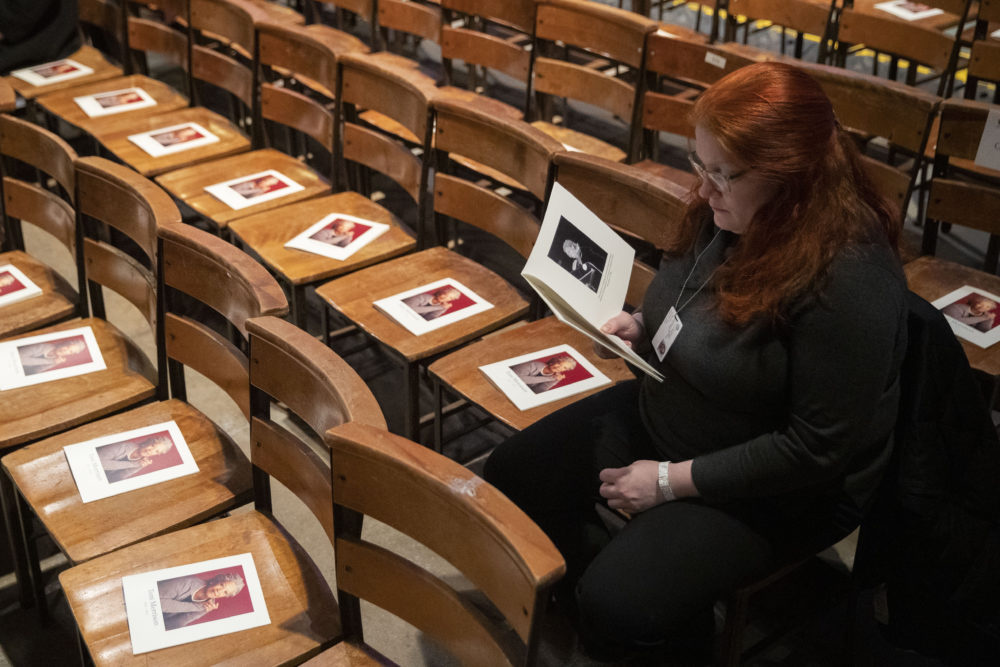 A woman looks through the program before the start of the Celebration of the Life of Toni Morrison on Nov. 21, 2019 at the Cathedral of St. John the Divine in New York. (Mary Altaffer/AP)