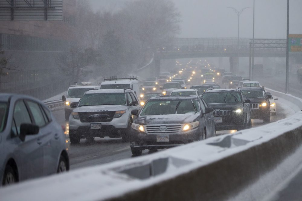 Commuters on Route 93 southbound move slowly as they leave Boston during a snowstorm. (Jesse Costa/WBUR)