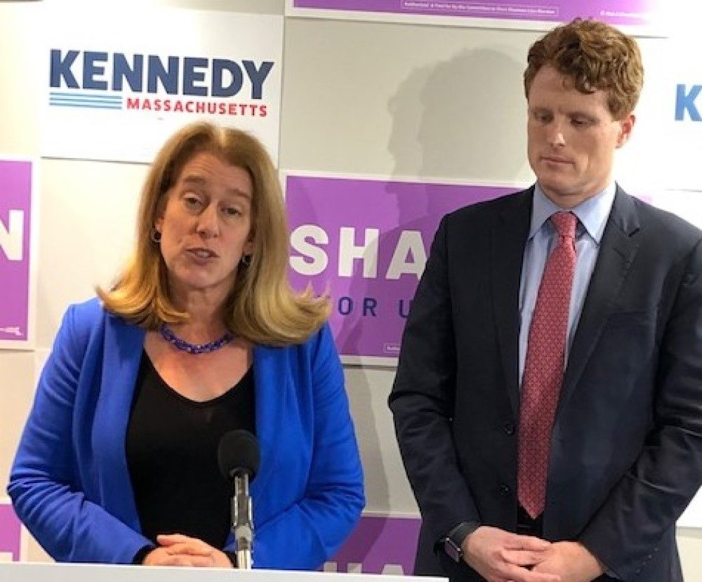 "Attorney Shannon Liss-Riordan and U.S. Rep. Joseph Kennedy III, both Democratic candidates for the U.S. Senate seat currently held by Ed Markey, speak after signing the ""People's Pledge on Monday, Dec. 2 (Anthony Brooks/WBUR)"