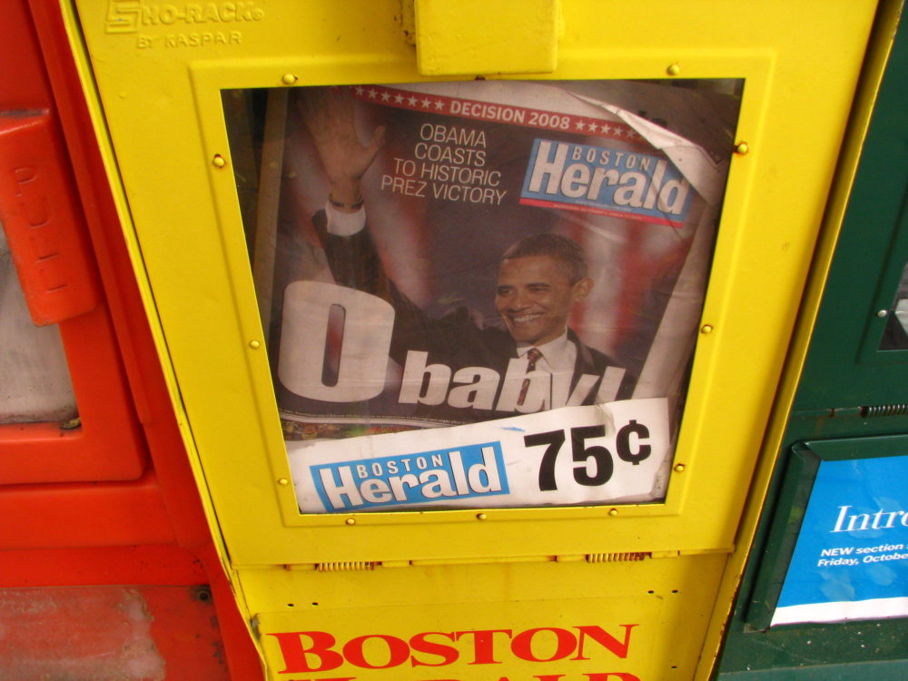 A newsstand holds Boston Herald newspapers. (sushiesque/flickr)