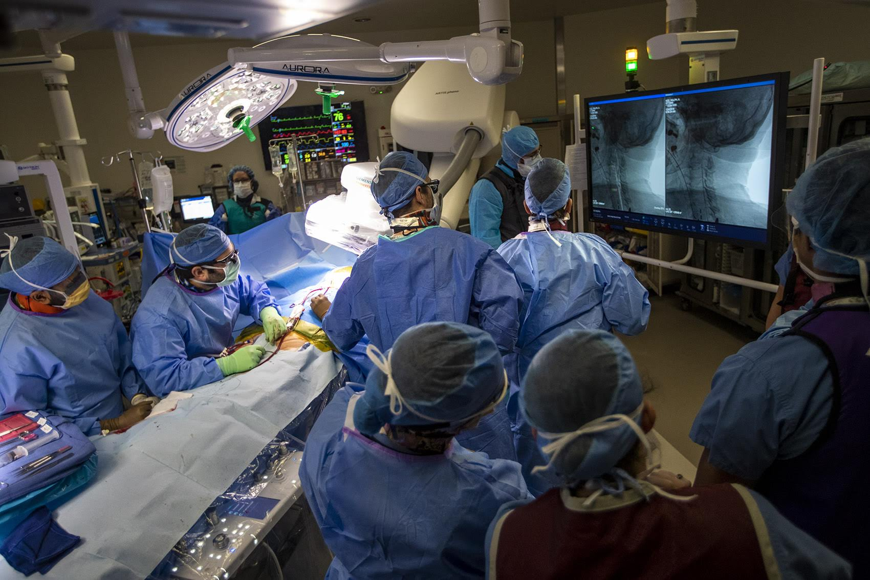 Vascular surgeon Doug Jones and his team perform a surgery to unblock the patient's carotid artery at Boston Medical Center. (Jesse Costa/WBUR)