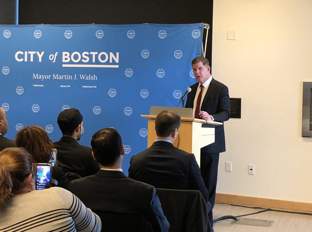 Boston Mayor Marty Walsh speaks at an event to sign amendments to the city's Trust Act. (Shannon Dooling/WBUR)