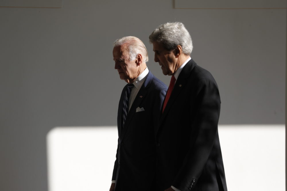 Secretary of State John Kerry and Vice President Joe Biden walk during a state arrival ceremony,in 2016. (Pablo Martinez Monsivais/AP)