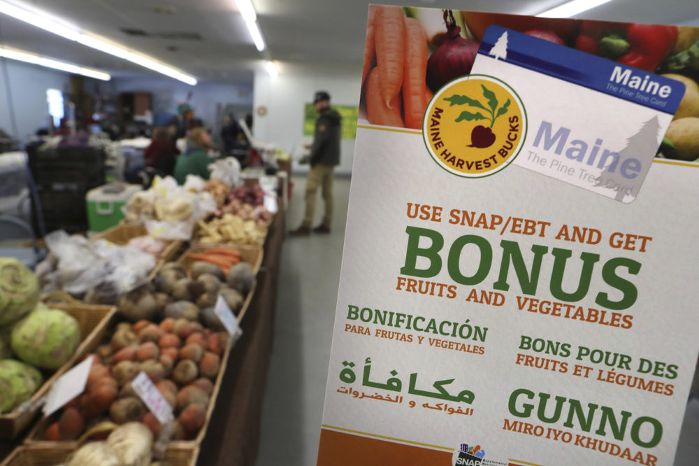 In this Friday, March 17, 2017 photo a sign advertises a program that allows food stamp recipients to use their EBT cards to shop at a farmer's market in Topsham, Maine. (Robert F. Bukaty/AP)