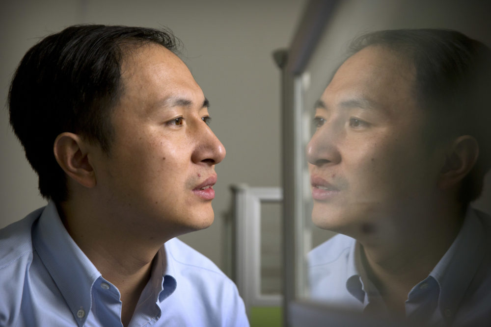In this Oct. 10, 2018 photo, He Jiankui is reflected in a glass panel as he works at a computer at a laboratory in Shenzhen in southern China's Guangdong province. Chinese scientist He claims he helped make world's first genetically edited babies: twin girls whose DNA he said he altered. (Mark Schiefelbein/AP)