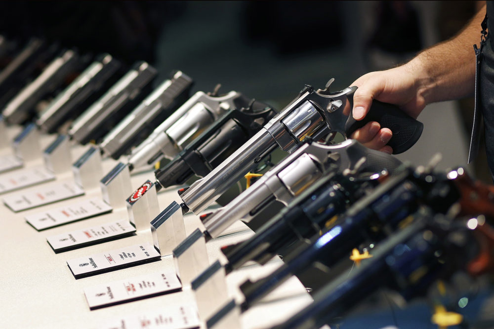 In this Jan. 19, 2016 file photo, handguns are displayed at the Smith & Wesson booth at the Shooting, Hunting and Outdoor Trade Show in Las Vegas. (John Locher, File/AP)