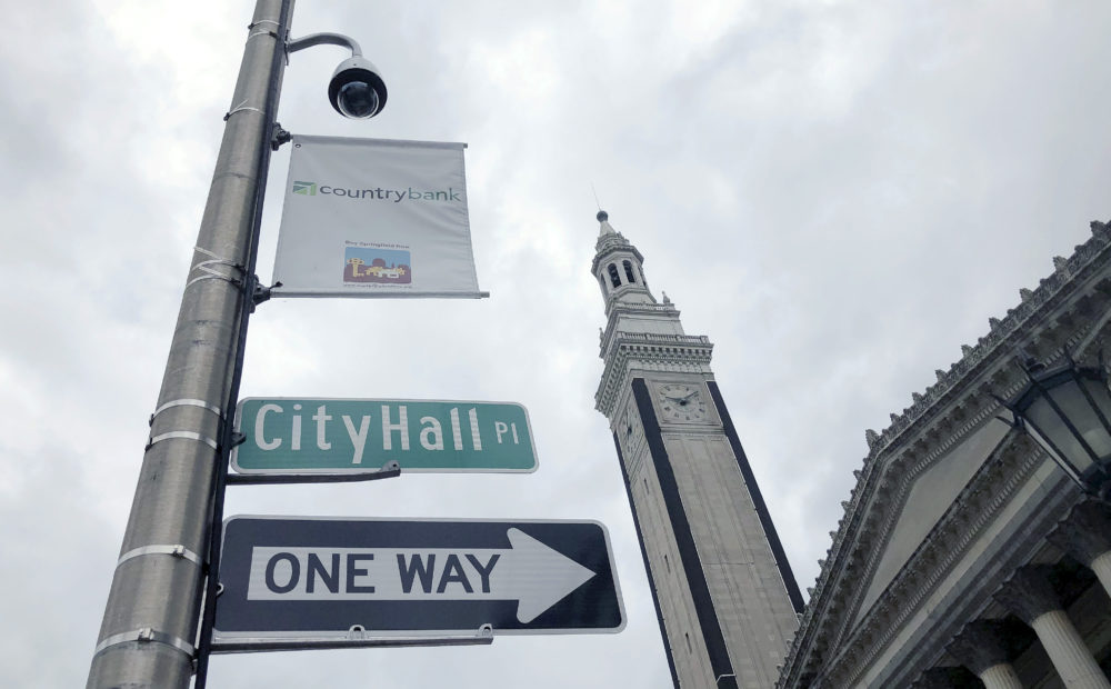 A video surveillance camera hangs on a pole outside City Hall in Springfield, Mass. (Matt O'Brien/AP)