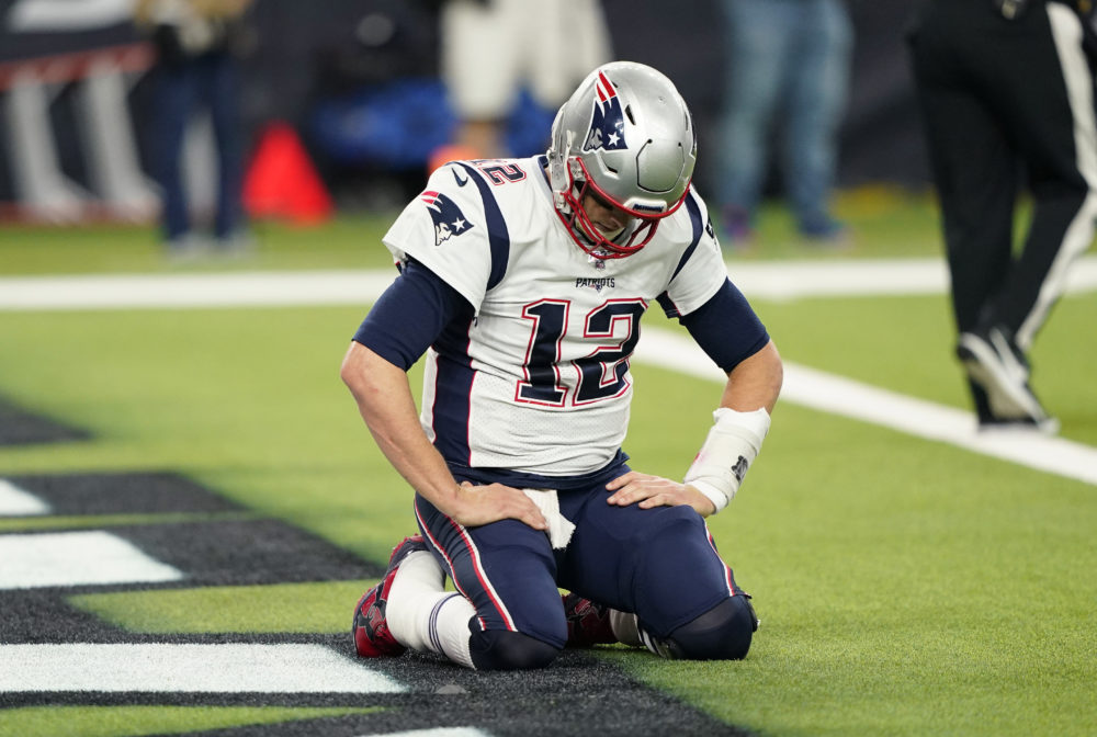New England Patriots quarterback Tom Brady (12) kneels on the turn after a play during the second half of the game Sunday in Houston. (David J. Phillip/AP)
