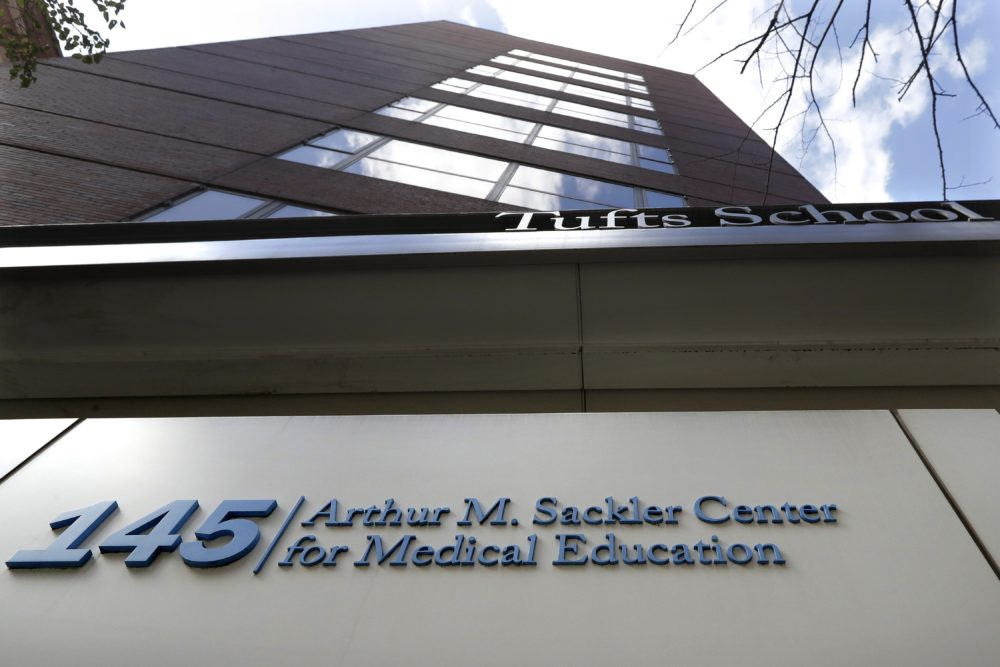 A sign at an entrance to Tufts School of Medicine, in Boston, identifies the address as the Arthur M. Sackler Center for Medical Education. Tufts announced Thursday, Dec. 5, it will strip the Sackler name from all of its institutions. (Steven Senne/AP/File)
