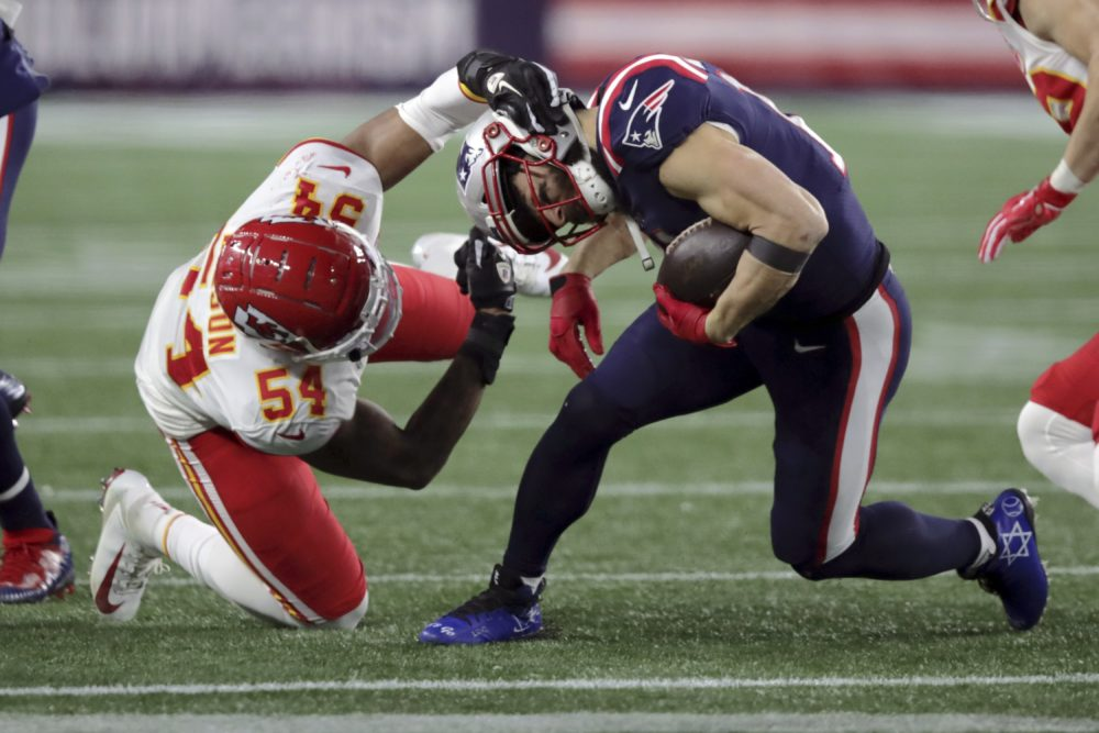 Kansas City Chiefs linebacker Damien Wilson, left, tackles New England Patriots wide receiver Julian Edelman in the second half of the game. (Charles Krupa/AP)