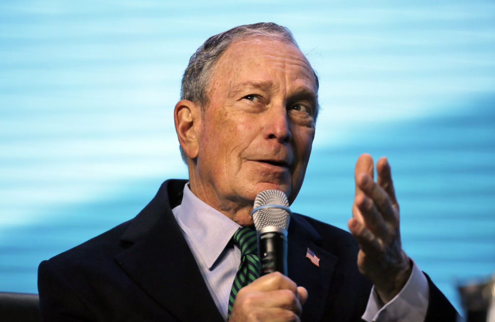 Democratic Presidential candidate and former New York City Mayor Michael Bloomberg gestures while taking part in an on-stage conversation with former California Gov. Jerry Brown in San Francisco on Dec. 11, 2019 (Eric Risberg/AP)