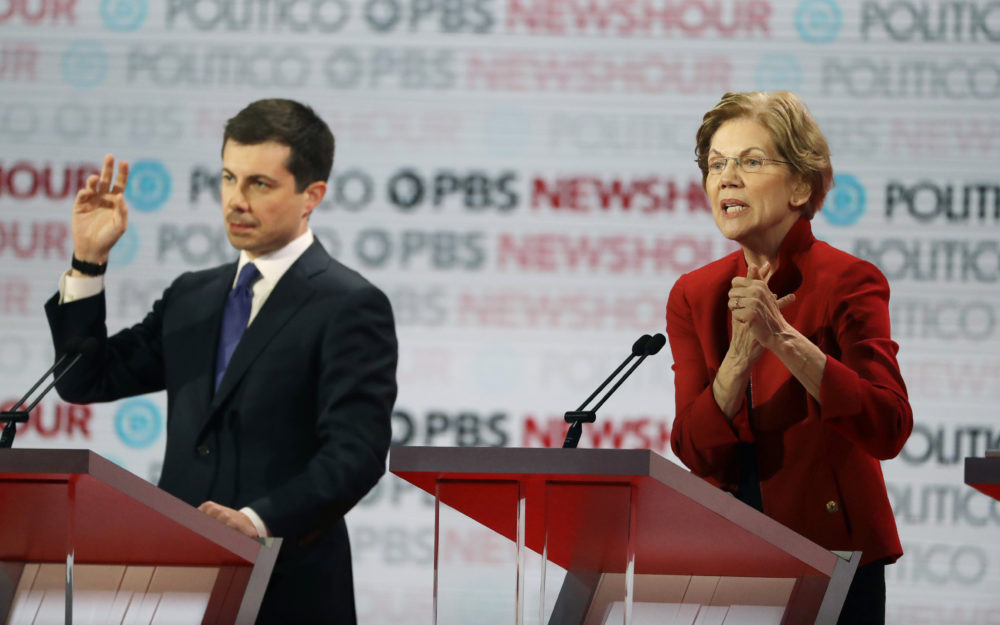 Democratic presidential candidate Sen. Elizabeth Warren, D-Mass., right, speaks beside South Bend Mayor Pete Buttigieg during a Democratic presidential primary debate Thursday, Dec. 19, 2019, in Los Angeles. (Chris Carlson/AP)
