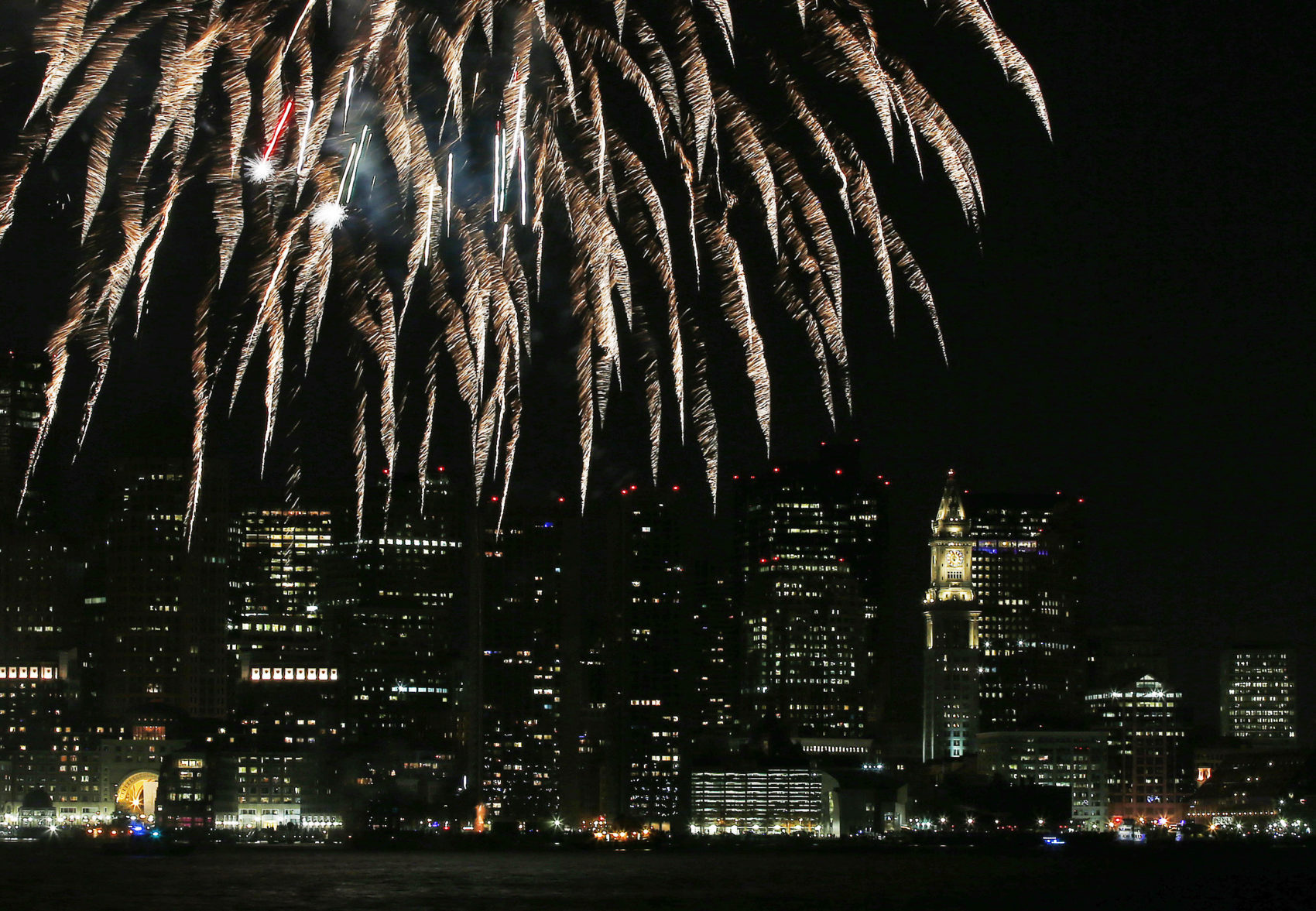 Fireworks light up Boston Harbor in 2014. (Elise Amendola/AP)