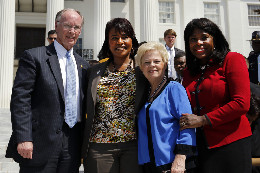 Former Republican Gov. Robert Bentley, Dr. Bernice King, Peggy Wallace Kennedy, and Rep. Terri Sewell, D-Ala., stand together in front of a crowd of people gathered at the steps of the Alabama State Capitol after a march from Selma, Ala., Wednesday, March 25, 2015, in Montgomery, Ala. (Butch Dill/AP)