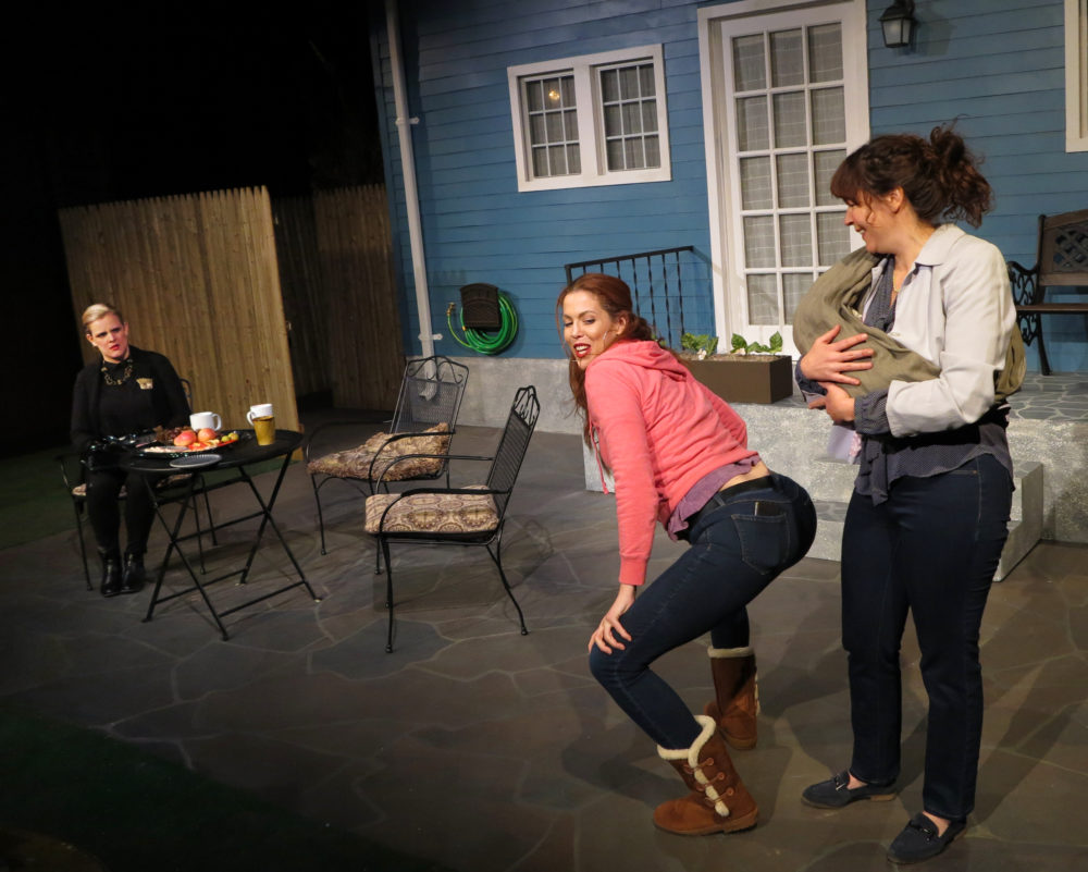 "Left to right: Amie Lytle as Adrienne, Lily Kaufman as Lina and Becca A. Lewis as Jessie in the Apollinaire Theatre Company's production of ""Cry It Out."" (Courtesy)"
