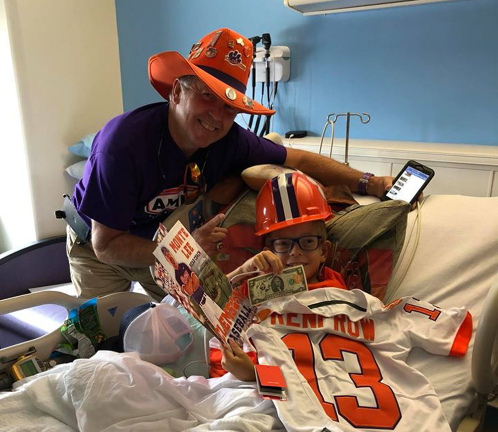 "When Aaron Ritz was diagnosed with a serious kidney condition, the Clemson community — including Dean ""The Hat"" Cox (left) — was there to lift his spirits. (Courtesy Aaron's Army)"