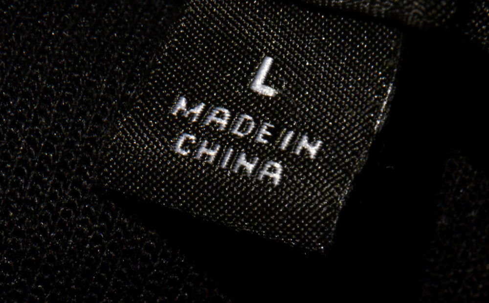 "A label inside an item of clothing reading ""Made in China."" (Johannes Eisele/AFP/Getty Images)"