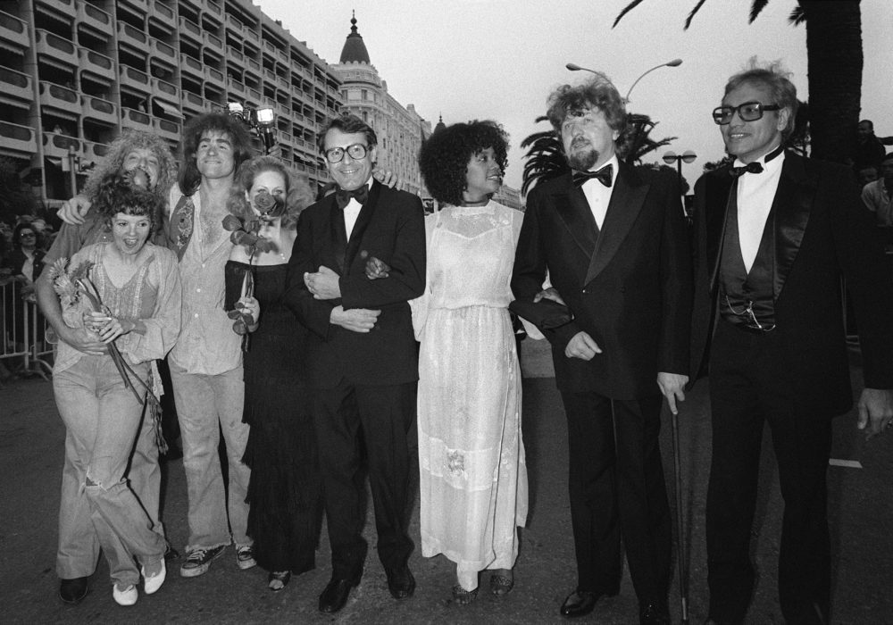 """Director Milos Forman (4th R) poses with the cast of his film """"Hair"""", US actress Annie Golden (L), US actors Donnie Dacus (2nd L) and Treat Williams (3rd L) and US actresses Beverly d'Angelo (4th L) and Cheryl Barnes (3rd R), on May 10, 1979 during the Cannes International Film Festival. (Ralph Gatti/AFP via Getty Images)"""