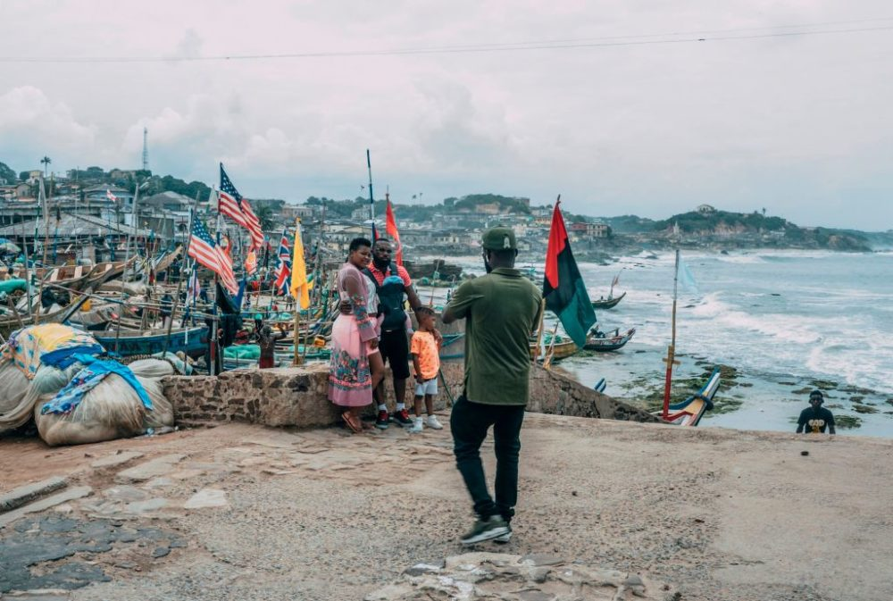 "Tourists pose for pictures at the Cape Coast Castle on August 18, 2019. Visitors are flocking to Ghana as it marks the ""Year of Return"" to remember the 400th anniversary of the first slave ship landing in Virginia. (Natalija Gormalova/AFP/Getty Images)"