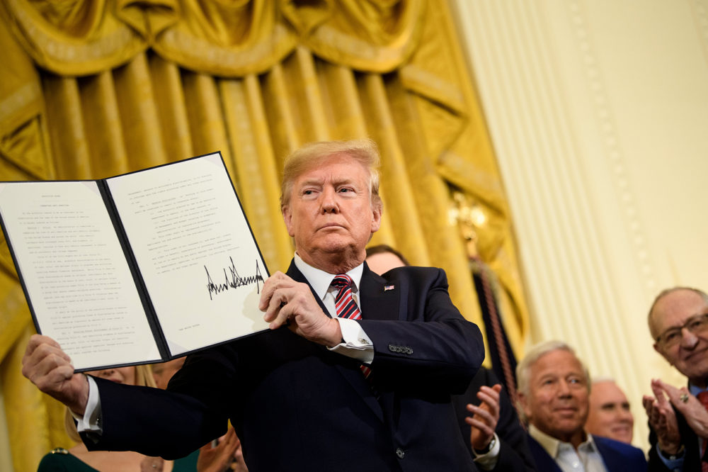President Trump shows an executive order regarding anti-Semitism during a Hanukkah reception in the East Room of the White House, Dec. 11, 2019. (Brendan Smialowski/AFP via Getty Images)