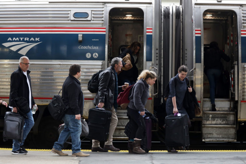 Passengers wait to board an Amtrak train. (Alex Wong/Getty Images)