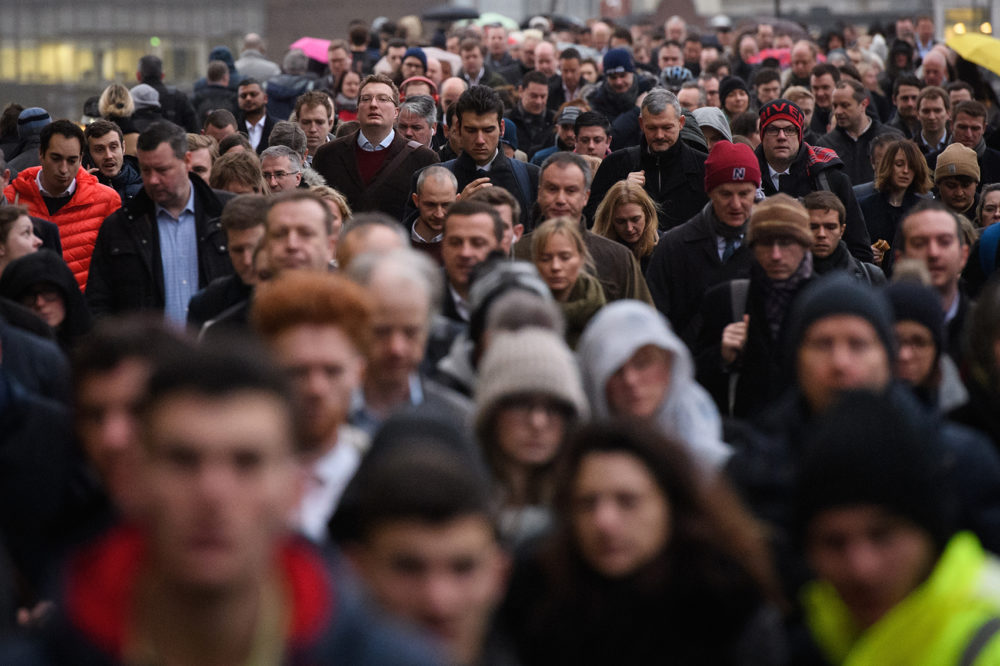 Commuters walk across London Bridge. (Leon Neal/Getty Images)