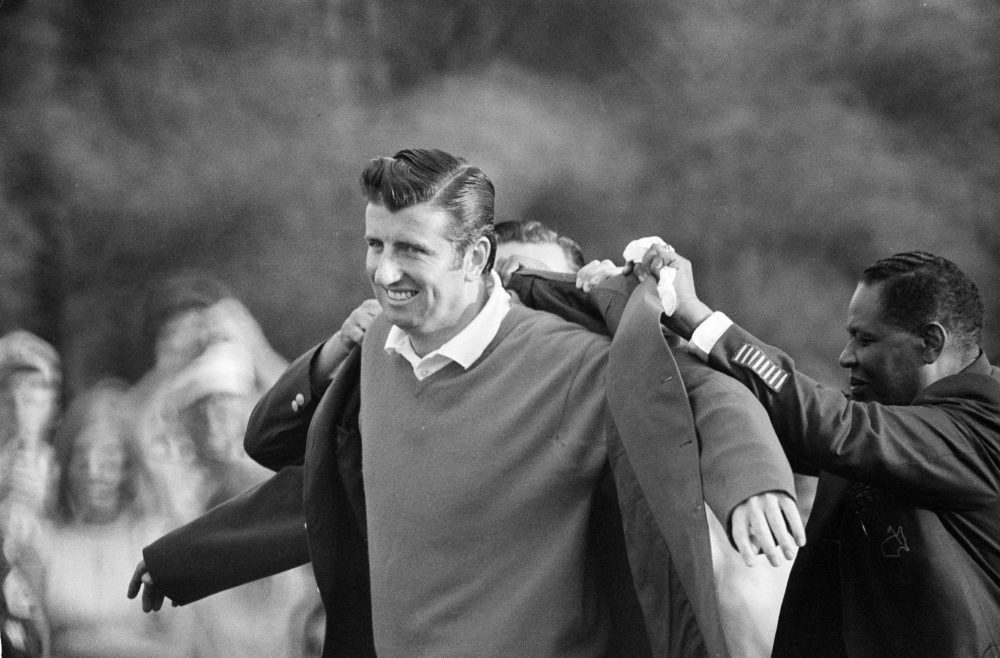 George Archer, winner of the 1969 Masters Tournament, is helped into his green jacket. (AP)