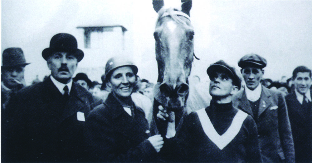 Lata Brandisová and her mare, Norma, as they're led away from the finish line of the 1937 Grand Pardubice. (Courtesy of Pospišil Archive)