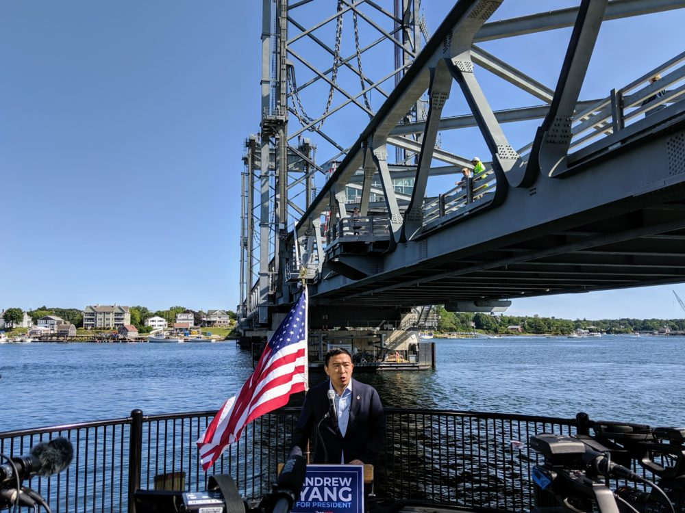 Andrew Yang announces his climate change plan on the Portsmouth, N.H. waterfront. (Annie Ropeik/NHPR)