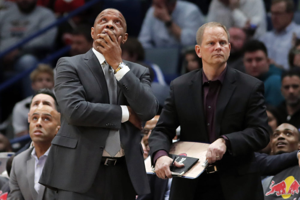 New Orleans Pelicans head coach Alvin Gentry, left, looks on in despair during Tuesday's game against the Brooklyn Nets. The game was the Pelicans' 13th consecutive loss, a franchise record. (Gerald Herbert/AP)