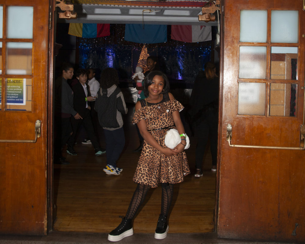 Middle schoolers attend the SneakerBall at the Helen Y. Davis Leadership Academy cafeteria on a recent Friday.