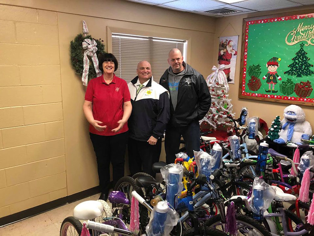 Bob Charland (right) just finished building 25 bikes that he plans to donate for Christmas. (Courtesy Bob Charland)