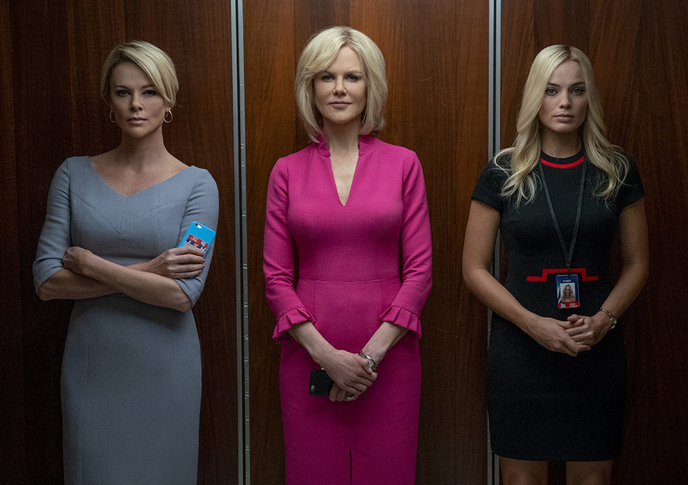 """Megyn Kelly (Charlize Theron, left), Gretchen Carlson (Nicole Kidman, center), and Kayla Pospisil (Margot Robbie, right) in """"Bombshell."""" (Photo by Hilary Bronwyn Gayle)"""